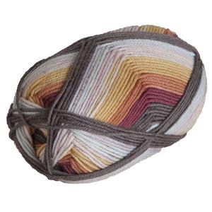 A multi-color bullet skein of yarn