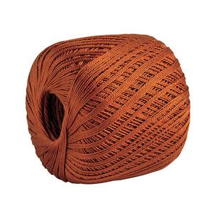 A hard core ball of burnt orange yarn