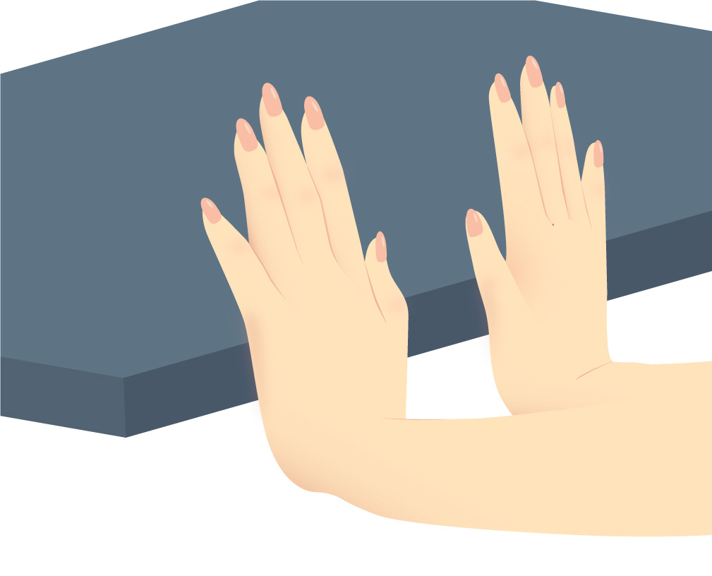 Hands with palms pushed against the edge of a blue table, doing the flexor knitter's exercise