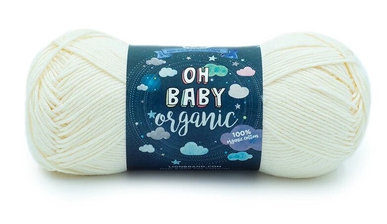 """A bullet skein of a white yarn with blue label that says """"Oh Baby Organic"""""""
