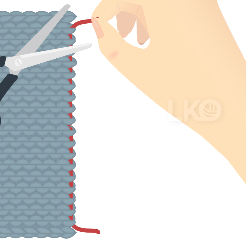 How to Weave in Yarn Ends into Seams Step 5: Cutting the excess yarn end from the edge of the knitted fabric.