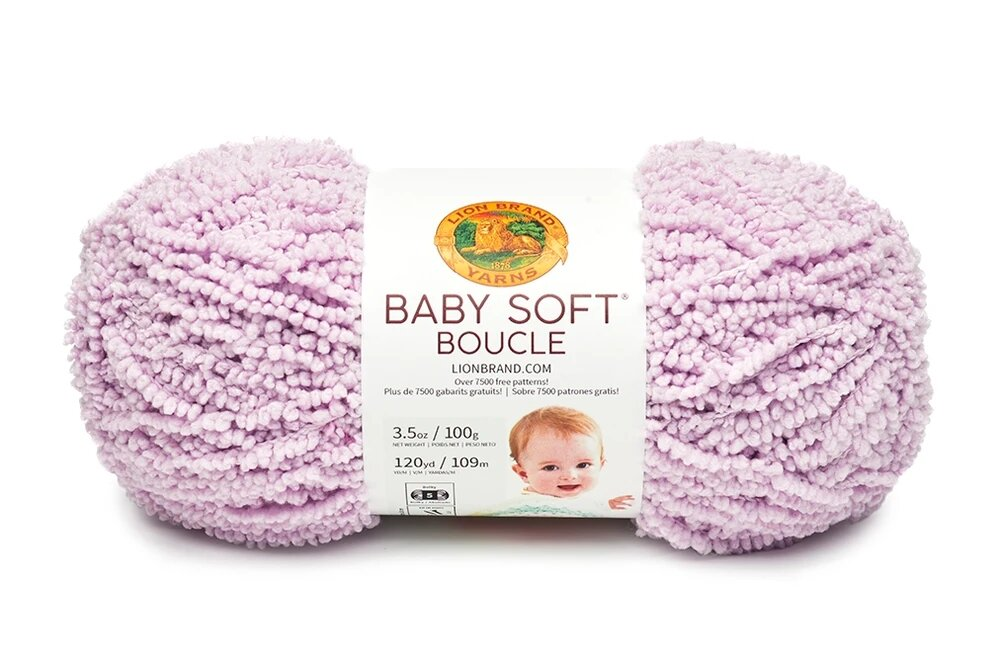 """A bullet skein of light pink textured yarn with a white label that says """"Baby Soft Boucle"""""""