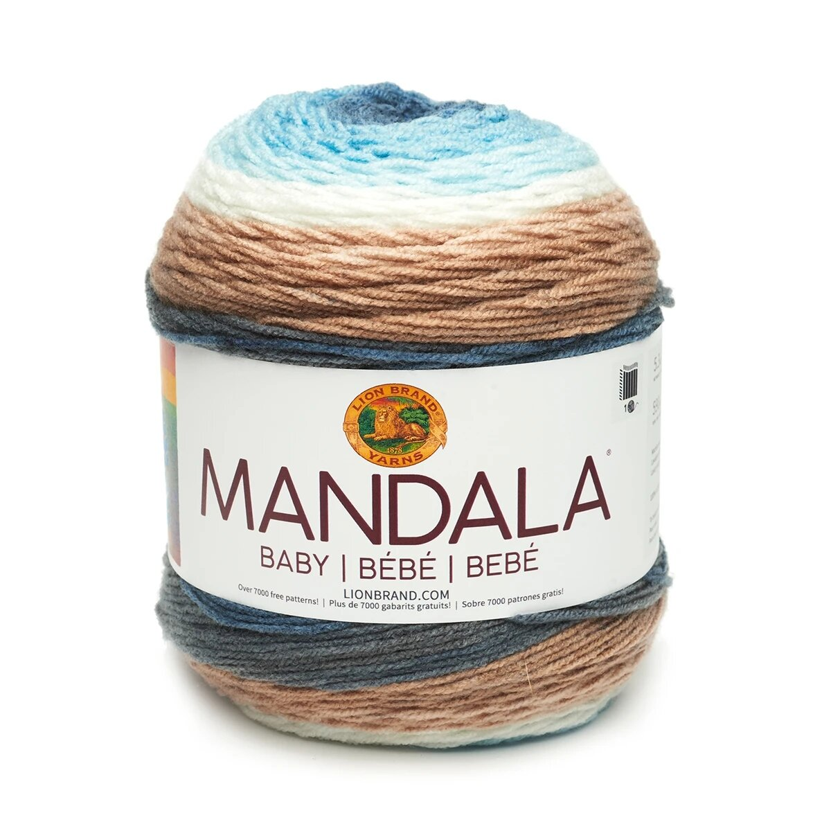 """A cake of blue, white and brown self-striping yarn with white label that says """"Mandala"""""""